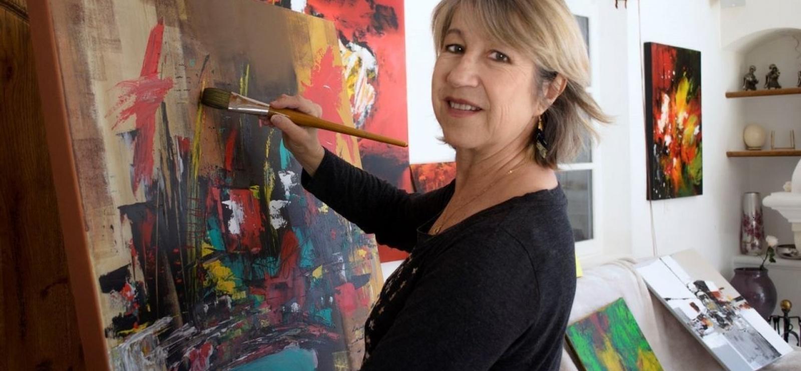 l'Artiste peintre à son travail.